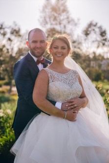 Bride and groom smiling at Stonecutters ridge golf club_05