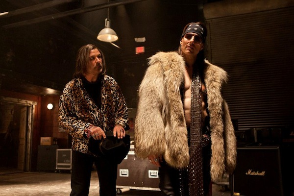 "(L-r) ALEC BALDWIN as Dennis Dupree and TOM CRUISE as Stacee Jaxx in New Line Cinema's rock musical ""ROCK OF AGES,"" a Warner Bros. Pictures release. © 2012 Warner Bros. Entertainment Inc. All Rights Reserved."