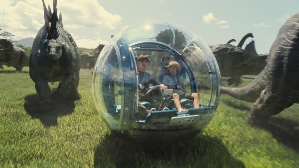 "(L to R) Zach (NICK ROBINSON) and Gray (TY SIMPKINS) roam among the dinosaurs in ""Jurassic World"". Steven Spielberg returns to executive produce the long-awaited next installment of his groundbreaking ""Jurassic Park"" series. Colin Trevorrow directs the epic action-adventure, and Frank Marshall and Patrick Crowley join the team as producers."