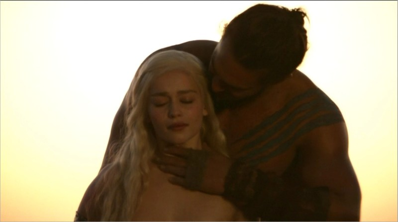 Emilia Clarke and Jason Momoa as Daenerys Targaryen and Khal Drogo in the first of many rape scenes in Game of Thrones.\