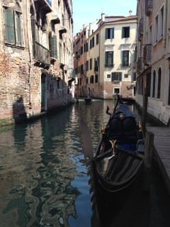 Side canal parking for gondolas in Venice, Italy