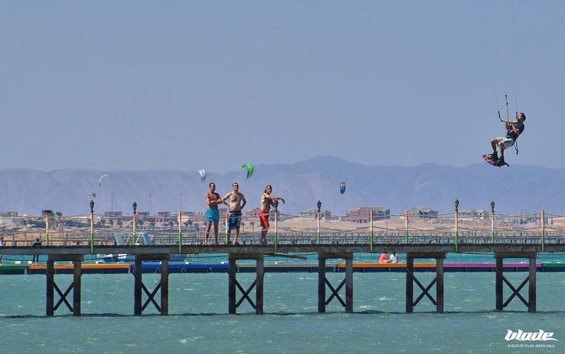 kitesurfer is doing extreme jump over the pier in Hurghada AMC - one of the best kitesurfing spots in Egypt