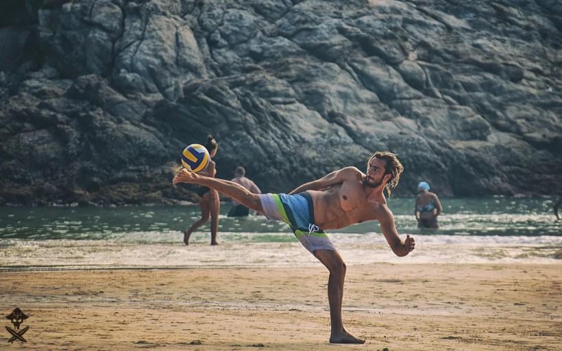 szymon is playin footbal on the Nai Harn beach in Rawai Thailand 2018