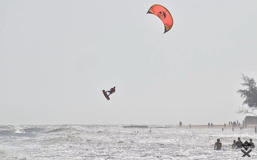 professional kitesurfer is doing big air kite loop during c2sky kite center competition in Mui Ne Vietnam 2018
