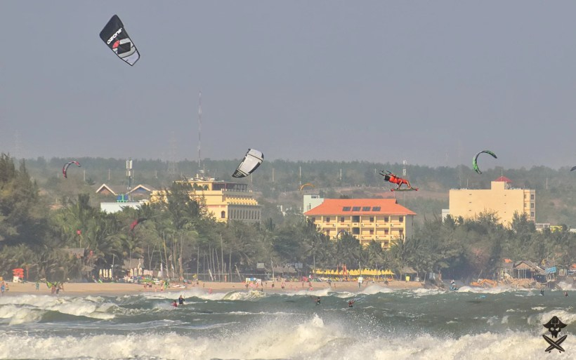 vietnamese pro kitesurfer Phu is doing late back roll megaloop during competition by c2sky in Mui Ne Vietnam