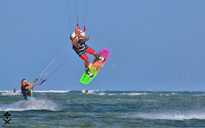 Adam Borian Borys owner of surfpoint school doing handle pass on Phan Rang best kitesurfing spot in Vietnam