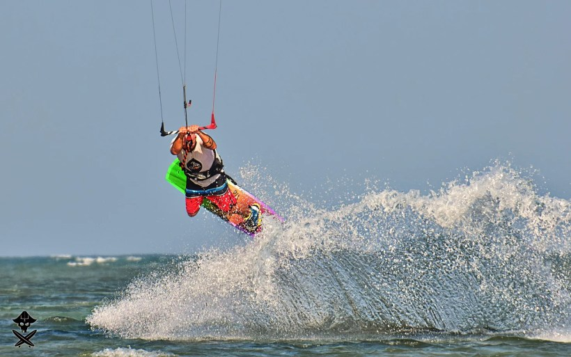 Adam Borys a seasoned kitesurfer doing powerful raley trick in Phan Rang