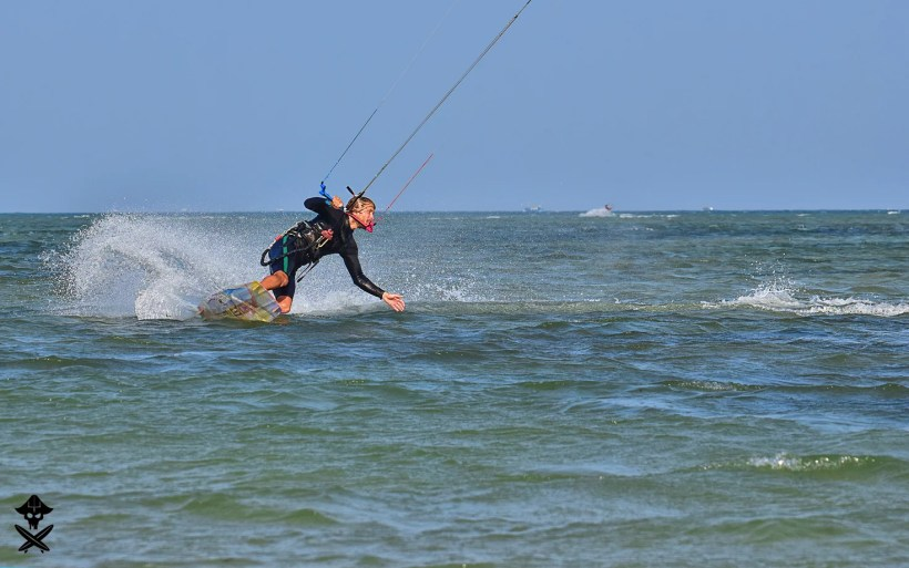 kitesurfer Michal Karski is doin nice curvy turn with his nobile board on the Phan Rang lagoon in Vietnam Surf Camping
