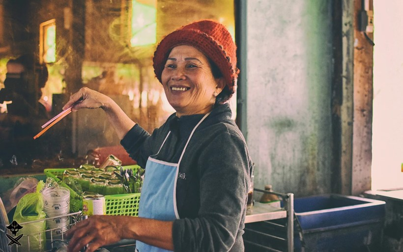 portrait of a vietnamese smiling lady working in the kitchen at some bar close to the highway connecting Mui Ne with Nha Trang