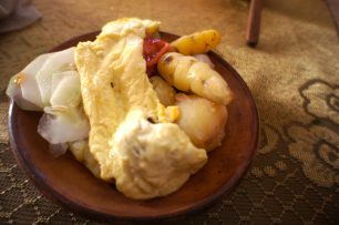 A plate of boiled potatoes and fried cheese during a Lake Titicaca Homestay.
