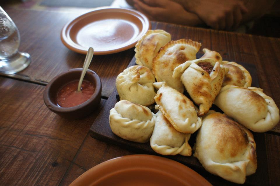 A mountain of baked empanadas