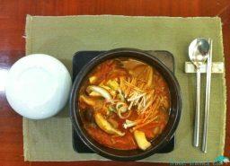 Black pork and mushroom kimchi stew