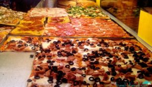 Pizza a taglio - tell the server how much you want and pay by weight