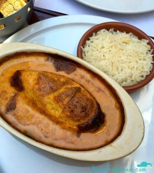 Pike quenelle with lobster sauce and rice