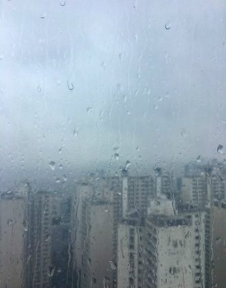 Monsoon rains over apartment buildings during summer in Seoul