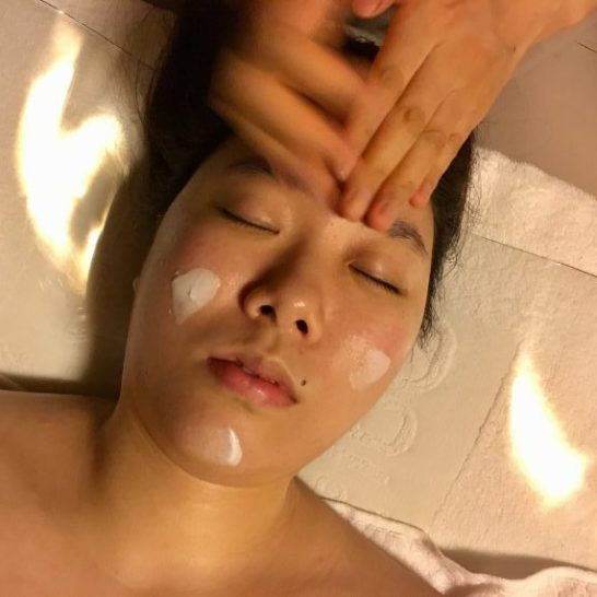 Application of ampoules during a facial in Seoul.