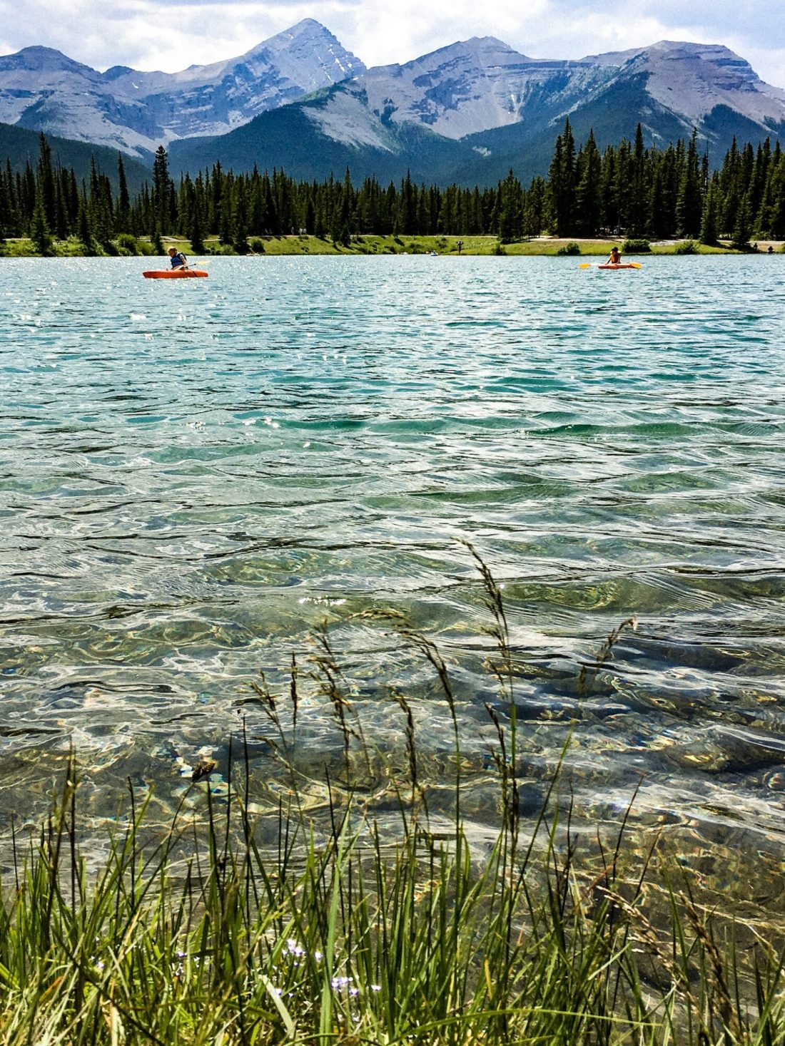 people paddling on forget me not pond in alberta