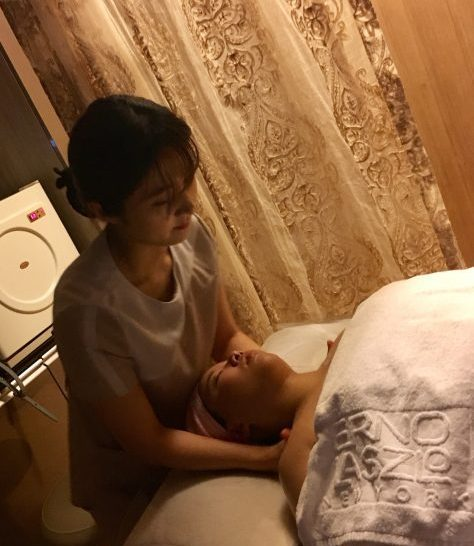 Neck and shoulder massage during a facial in Korea.