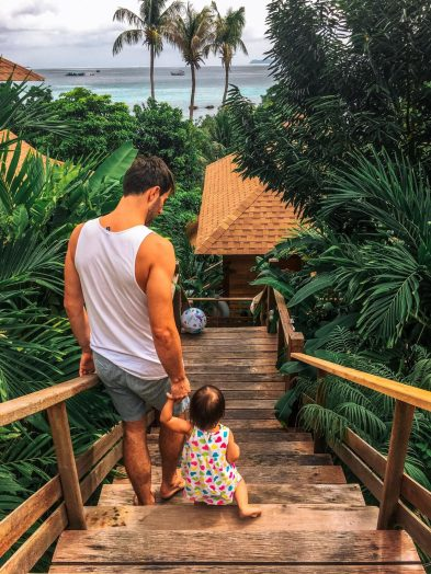 daughter and dad climbing down stairs at Ten Moons Lipe Resort