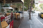 <h5>Athens cafe. Tables almost on the sidewalk.</h5>