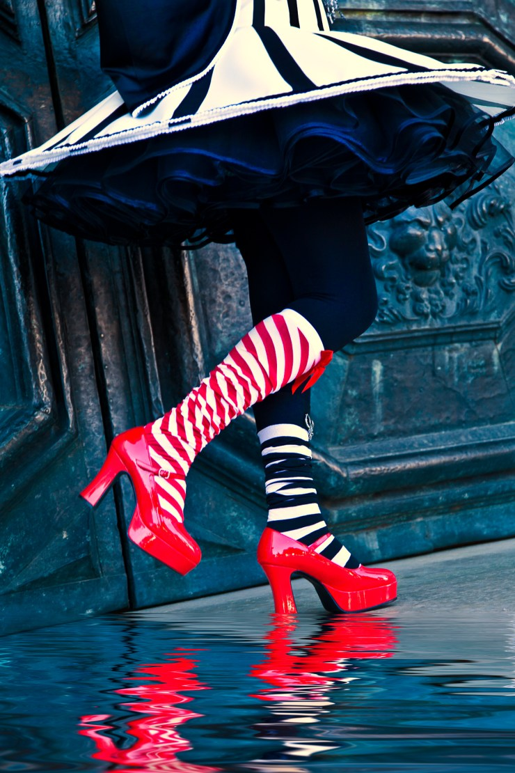Bright red shoes and striped socks at Carnival in Venice