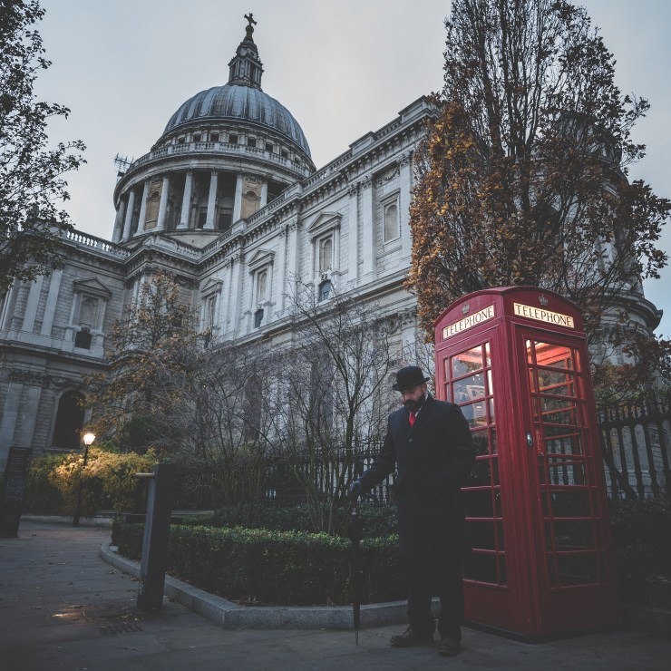 The Bowler Man outside St Pauls Cathedral. Next to one of those famous red telephone boxes.