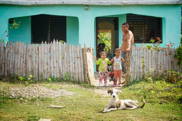 A family poses in their front yard in the countryside just out of Trinidad. Photographed on a Tamron 70-200mm f/2.8 at 1/640 and f/3.5.