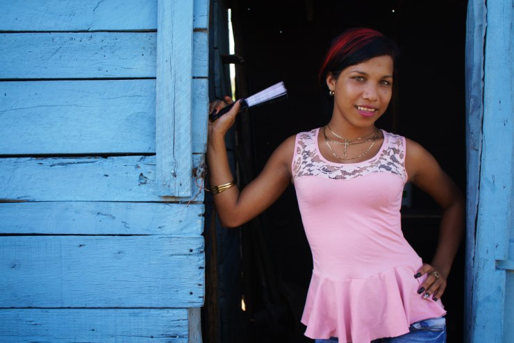 A girl poses in the doorway near a restaurant on one of the quiet roads in Eastern Cuba. Photographed on a Tamron 35mm f/1.8 at 1/200, f/3.5.