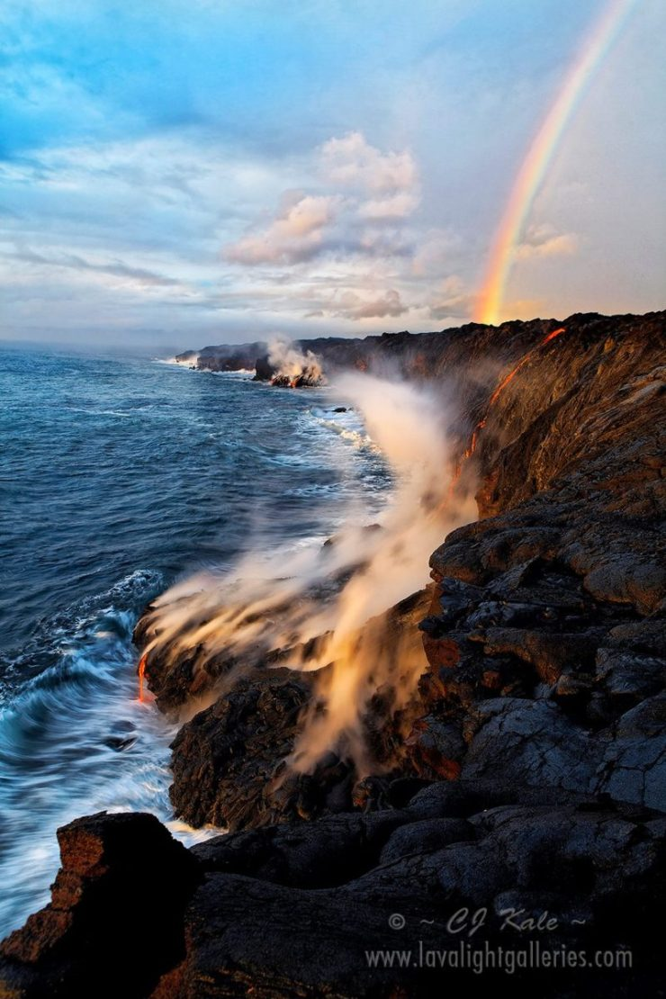 A rainbow appears over the lava filled coastline of Hawaiʻi Volcanoes National Park on the Big Island of Hawaii. Photo by CJ Kale.