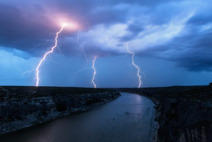 Three bolts strike in the hills north of where Highway 90 crosses the Pecos River.