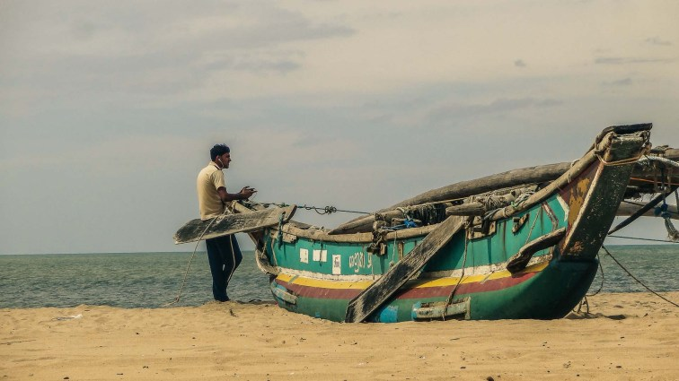Dude listening to music on the beach in Negombo, Sri Lanka