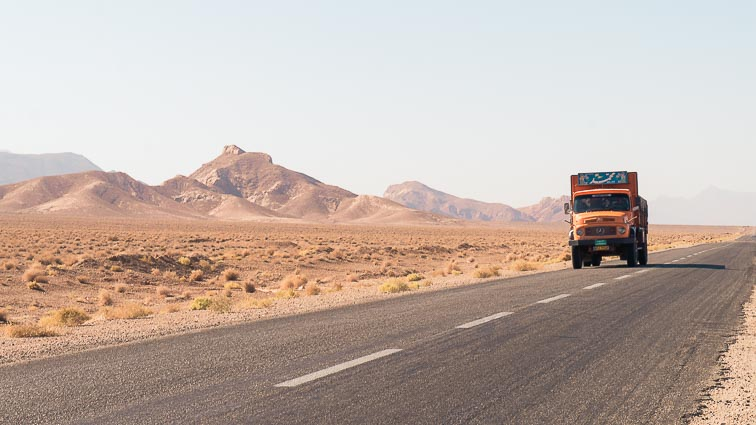 Renting a car in Iran. Car rental Iran. Traffic in Iran. Big, old trucks dominate the roads in Iran