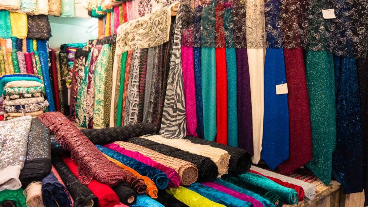 Nice fabric on a market in Iran. How expensive is Iran to Travel? Cost of travel in Iran.