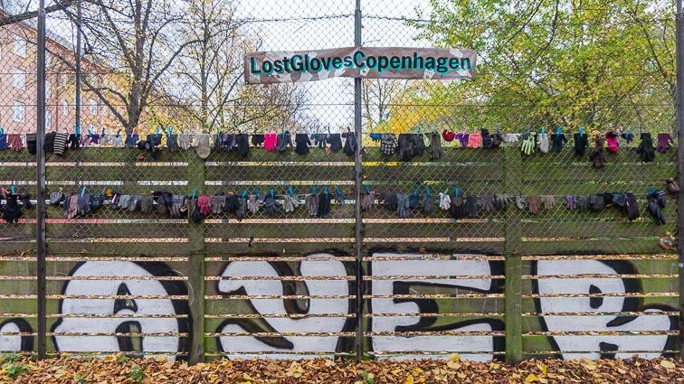 Dozens of lost gloves on a fence. #LostGlovesCopenhagen