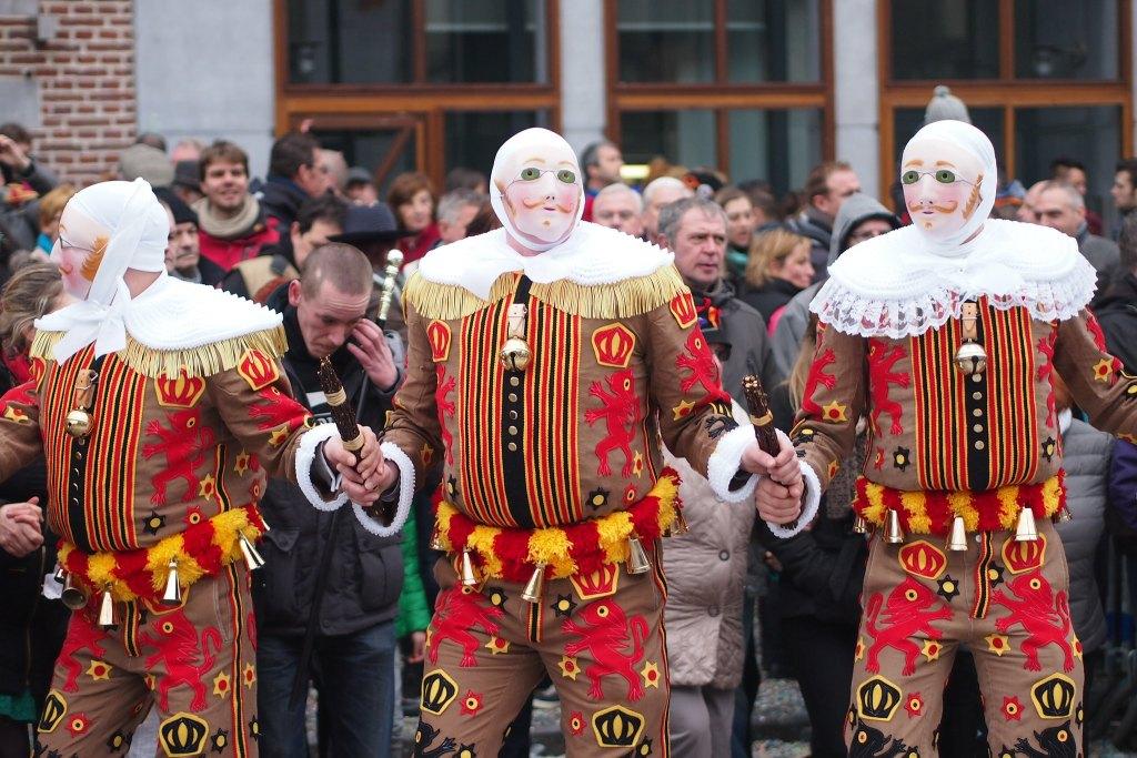 Three men dressed as Gilles in Binche