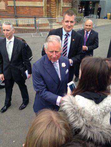 Prince Charles greeting the crowd.