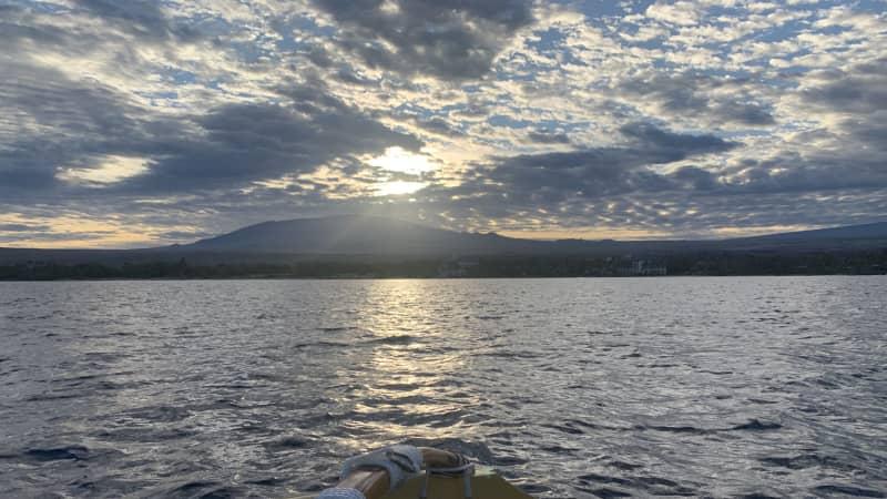 Watch the sunrise over Mauna Kea from an outrigger canoe.