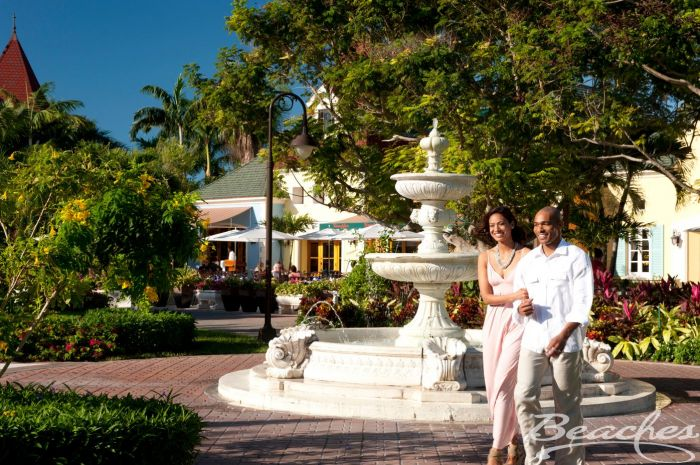 couple walking by fountain