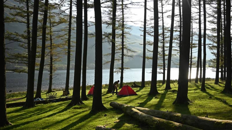 Campers in Buttermere Lake in England's Lake District in August 2020.