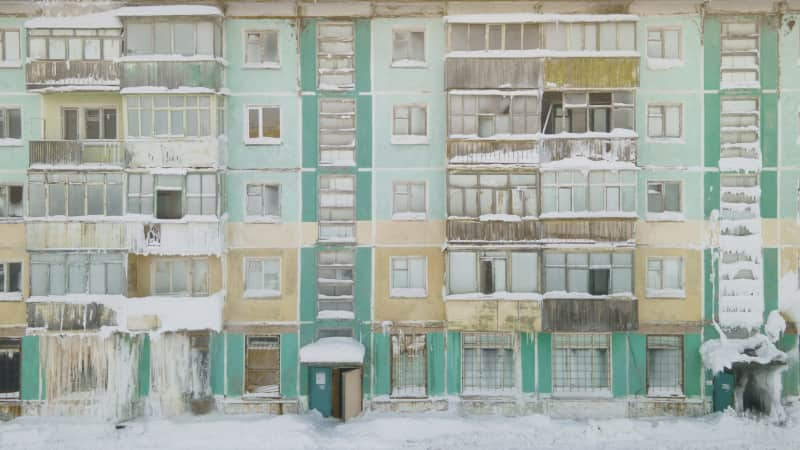 This photo was taken in the village of Severny. Passer says some people still live in this building.