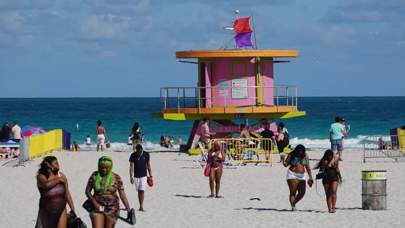 Spring break has sparked tension in Miami Beach, Florida, over concerns about virus transmission.