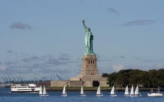 The 150ft high Lady Liberty stands tall in New York Harbor as a symbol of liberty and freedom to immigrants