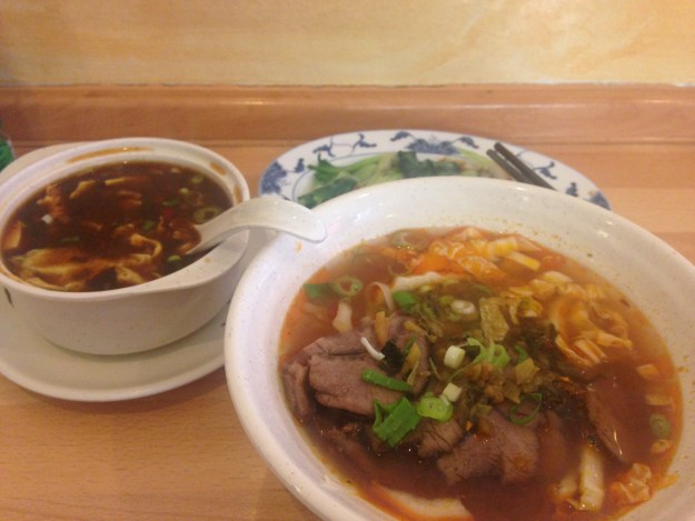Taiwanese food - Beef noodle soup, hot and sour soup, and veggies