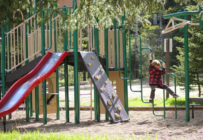 kid on play structure