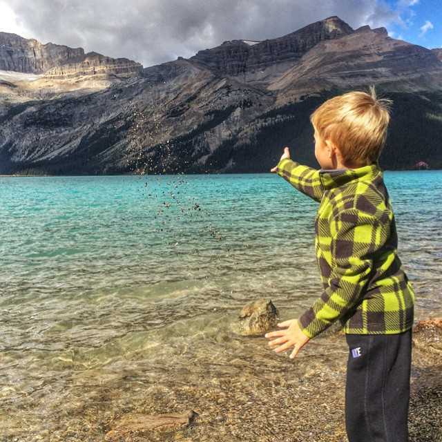 Zevin throwing rocks into the Bow River