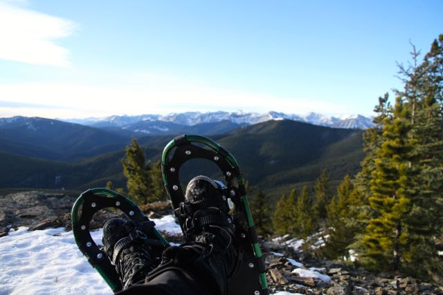 Snowshoeing on a mountain view