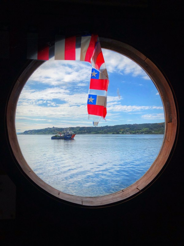 A porthole view from inside the Cocineria Dalcahue in Chiloé, Chile Jenn Smith Nelson