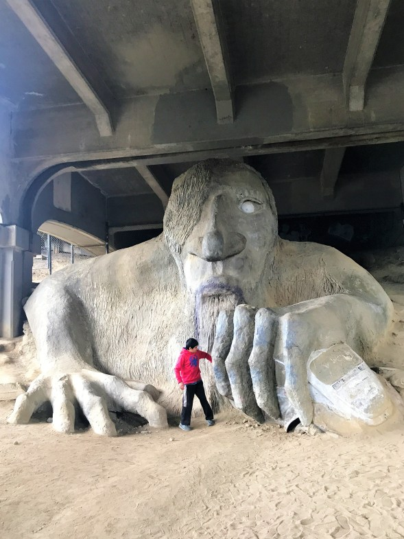 Check the Volkswagen Beetle clutched in his hands at Fremont Troll, Under Aurora Bridge, Seattle famous Instagram Spots
