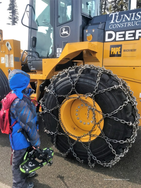 View of Snow Removal vehicle with heavy chains on wheel for traction purpose at Mount Rainier National Park.  Paradise Parking lot.