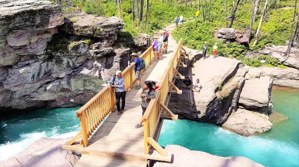 Wooden Bridge across stream waters of St Mary Falls Glacier National Park